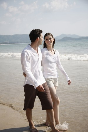 Man and woman walking along the beach Stock Photo - 7355989