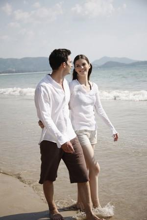 Man and woman walking along the beach Stock Photo - 7355989