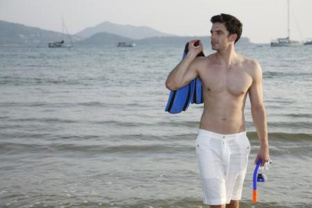 Man carrying snorkeling gear Stock Photo - 7356042