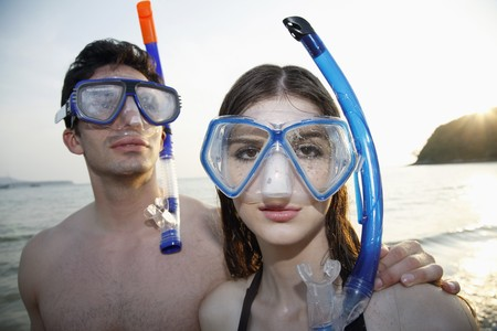 Man and woman with scuba mask photo
