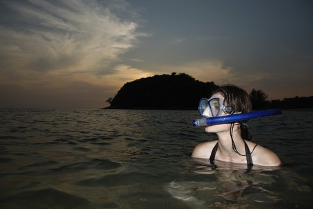 Woman with scuba mask in sea photo