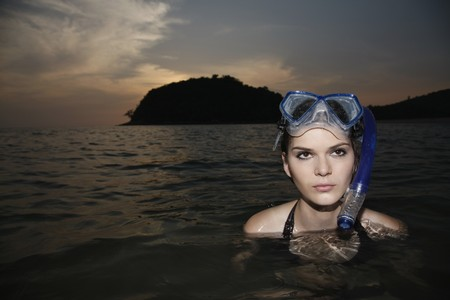 southeastern european descent: Woman with scuba mask in sea