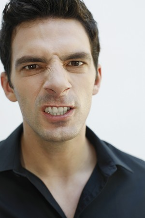 Man clenching his teeth Stock Photo - 7355839