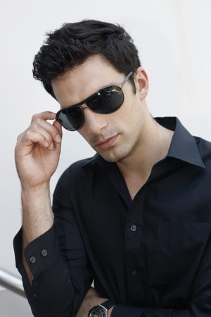 Man adjusting sunglasses photo