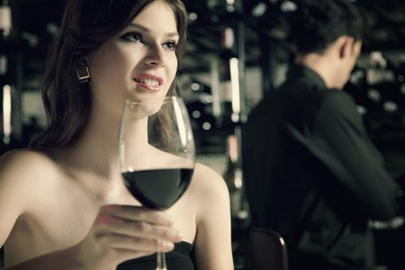 angle bar: Woman with a glass of red wine