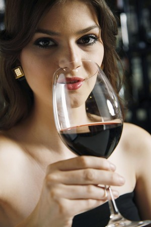 Woman drinking red wine photo
