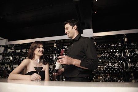 Man recommending good wine to woman Stock Photo - 7359266