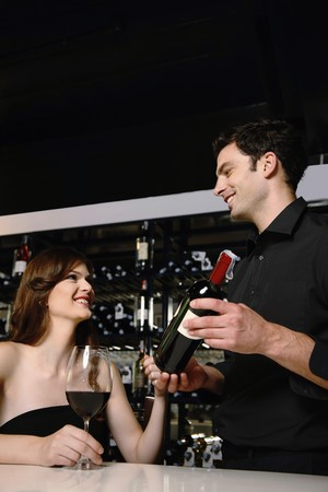 recommending: Man recommending good wine to woman