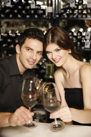 Man and woman toasting photo