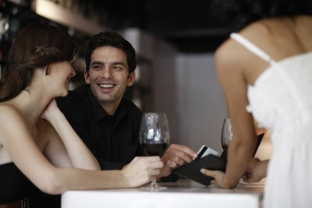 side bar: Man paying the bill with credit card