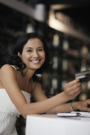 Woman smiling while holding credit card photo