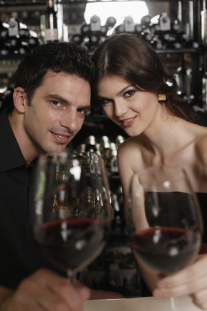 Man and woman toasting Stock Photo - 7360391