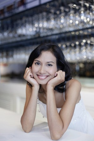 Woman sitting at the bar smiling photo