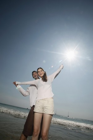 Man and woman with arms stretched out Stock Photo - 7359259