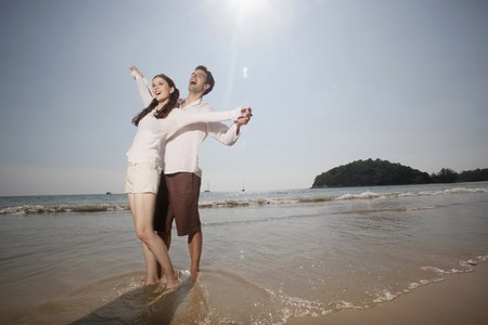 Man and woman with arms stretched out Stock Photo - 7360528