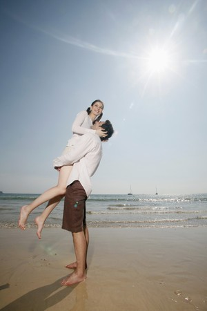lift and carry: Man lifting up woman  Stock Photo
