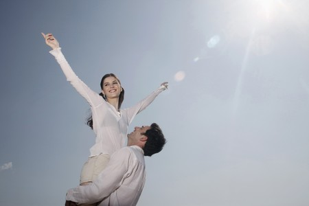 southeastern european descent: Man lifting up woman  Stock Photo
