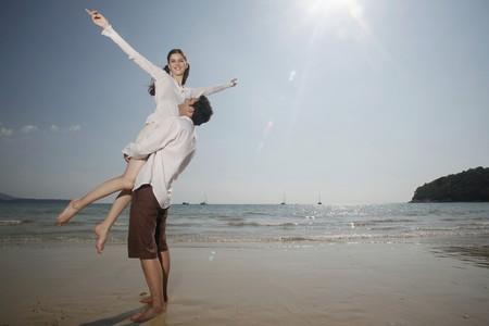 man carrying woman: Man lifting up woman  Stock Photo