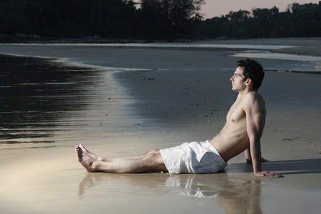 Man resting on the beach Stock Photo - 7360834