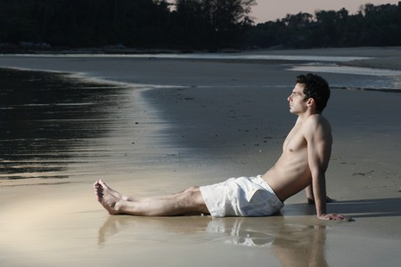 sea side: Man resting on the beach