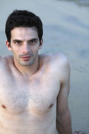 Man resting on the beach photo