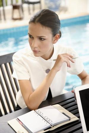 Businesswoman contemplating photo