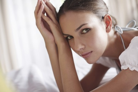 Woman lying on front on bed photo