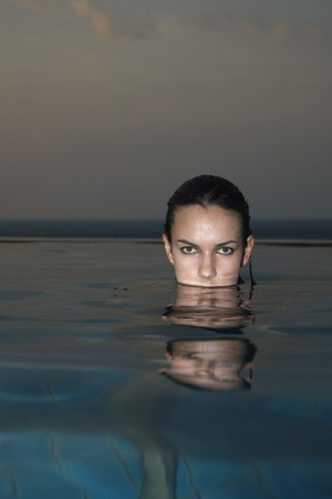 Woman in the pool, head above water photo