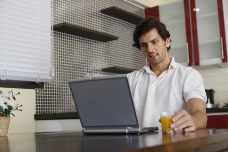 Man using laptop Stock Photo - 7360530