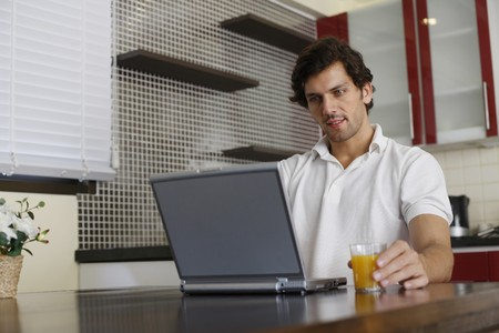 Man using laptop Stock Photo - 7360530