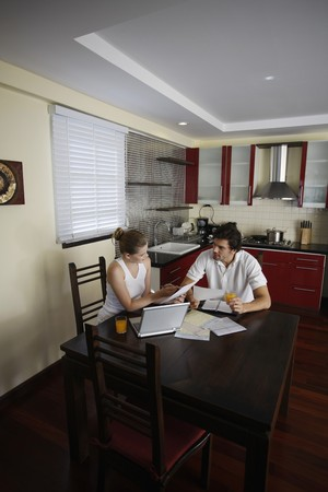 sorting out: Man and woman sorting out bills together Stock Photo