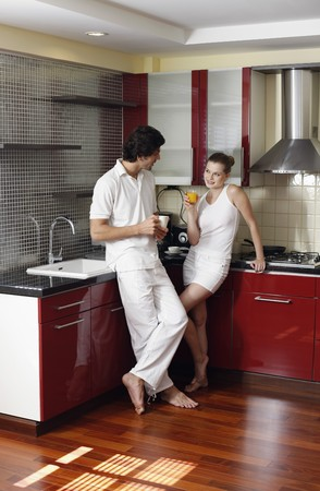 Couple enjoying beverages in the kitchen Stock Photo - 7360975