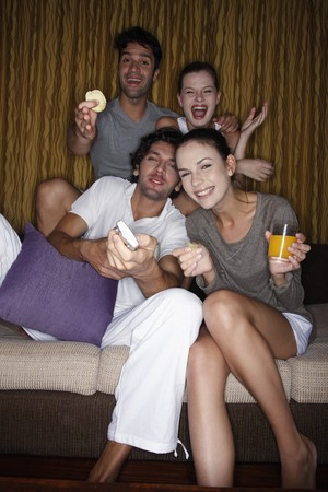 Couples watching tv together photo