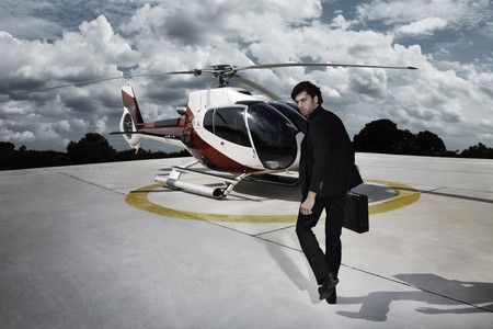 Businessman walking towards helicopter