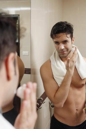 southeastern european descent: Man applying shaving cream Stock Photo