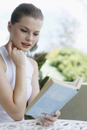 Woman reading a book Stock Photo - 7359297