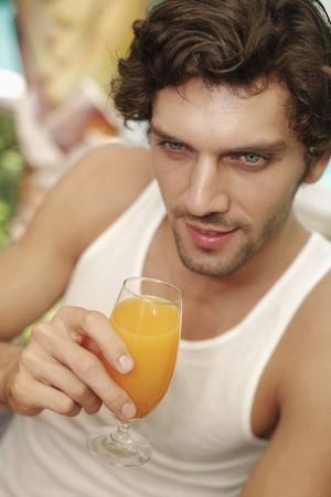 Man holding a glass of orange juice Stock Photo - 7359227