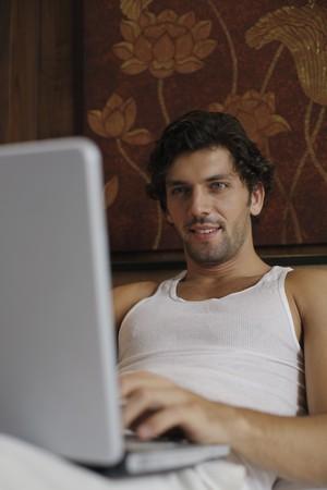 Man using laptop Stock Photo - 7359289