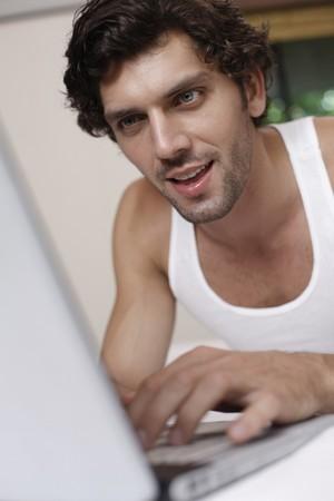 Man using laptop photo