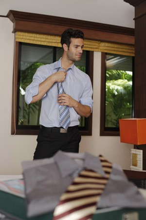southeastern european descent: Businessman loosening his tie Stock Photo
