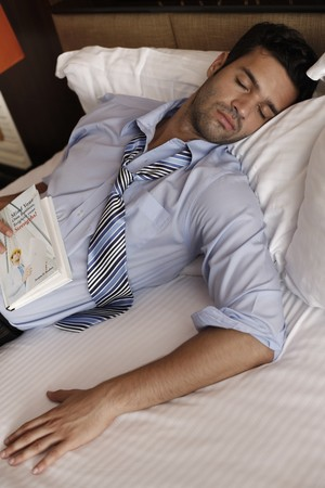 Businessman sleeping after reading photo