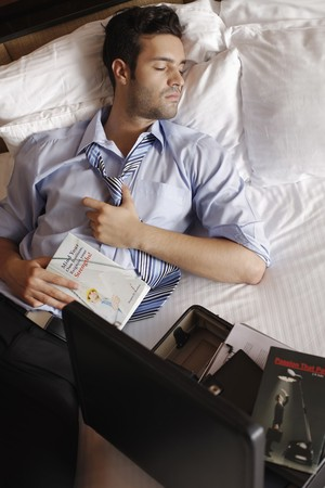 Businessman sleeping after reading Stock Photo - 7360881