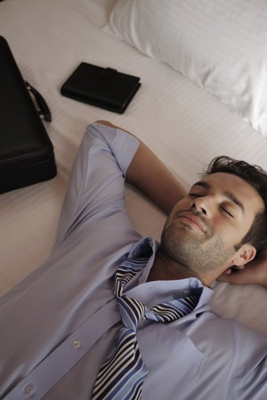 Businessman having a nap Stock Photo - 7359216