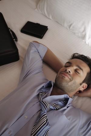 Businessman having a nap Stock Photo - 7359216