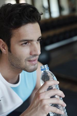 Man holding water bottle Stock Photo - 7360408
