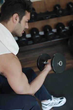 Man lifting weights photo