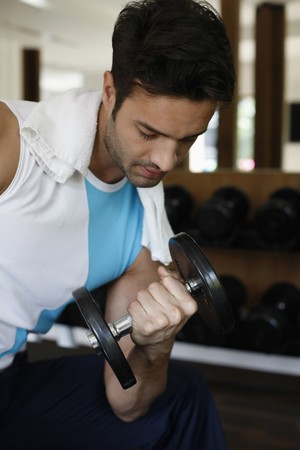 southeastern european descent: Man lifting weights Stock Photo