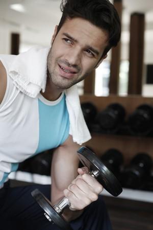Man lifting weights Stock Photo - 7359146