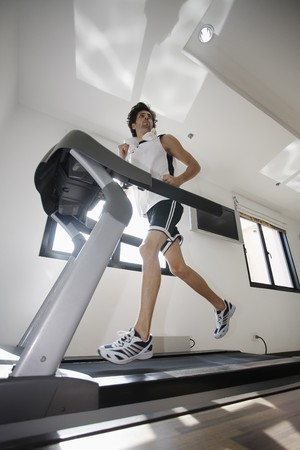 Man running on treadmill photo