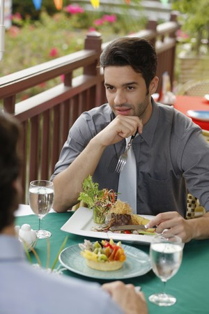 Businessmen having lunch at a restaurant photo